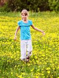 Child  running in  field. Happy little girl  running in  field Stock Photography