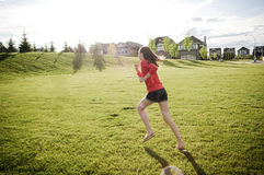 Child running in the field in summer Stock Photos