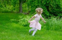 Child running through a garden Royalty Free Stock Image