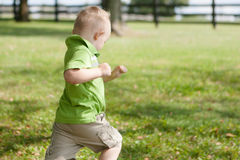 Child Running Outside Royalty Free Stock Image