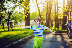Child running on the park on sunset rays. Stock Image