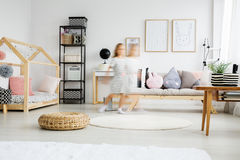 Child running in pastel apartment Royalty Free Stock Photos