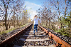Child running in railway Royalty Free Stock Image