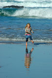 Child running in sea Royalty Free Stock Image
