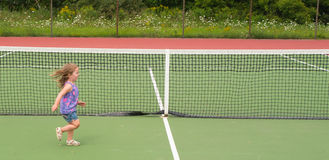 Child Running Tennis court Royalty Free Stock Image