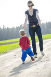 Child running to his mum Royalty Free Stock Image