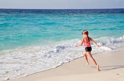 Child running to ocean stock photo