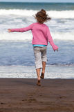 Child running to the ocean. Happy little girl running to the ocean Royalty Free Stock Photography