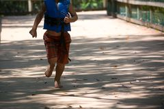 Child Running on Walkway in the Park in a Hot Day. On Blur Background. Turkey Creek, Niceville, Florida royalty free stock image