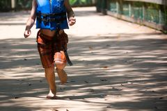 Child Running on Walkway in the Park in a Hot Day. On Blur Background. Turkey Creek, Niceville, Florida stock photo