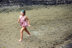Child running in water Stock Photos
