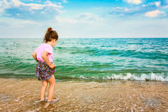 Child running on water at ocean beach. Royalty Free Stock Photography
