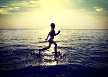 Child running on the Water Stock Photo