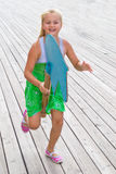 Child running with a wooden horse Royalty Free Stock Images