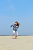 Child runs on the beach Royalty Free Stock Images
