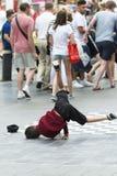 A child runs a brake-dance. ANTWERP, BELGIUM - JULY 5, 2015: A child runs a brake-dance in the middle of the street, to the amazement of passersby Stock Photos