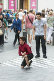 A child runs a brake-dance Stock Images