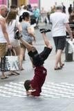 Child runs a brake-dance Stock Photos