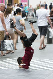 Child runs a brake-dance. ANTWERP, BELGIUM - JULY 5, 2015: A child runs a brake-dance in the middle of the street, to the amazement of passersby Stock Photos
