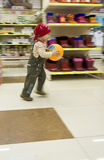 Child runs and game of ball. The camera moves for the boy Royalty Free Stock Photography