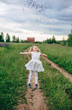 Child runs and jumps on a path in the field Royalty Free Stock Images
