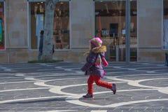 The child runs in park Stock Photo