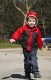 Child runs through a park Stock Image
