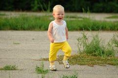 Сhild runs and smiles Stock Photography