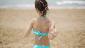 Child runs to the sea stock video