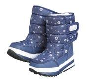 Child& x27; s冬天在白色隔绝的雪地靴 库存图片