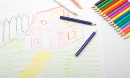 Child's art. Color pencils and child's picture. Two light sources Royalty Free Stock Image