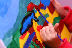Child's art. Small girl is paiting. Different point of veiw an art Stock Images