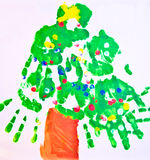 Child's Art Work/ Tree. A tree made from a child's hand prints.  This could be used for Christmas or any time Royalty Free Stock Images