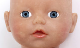 Child's baby doll face Stock Images