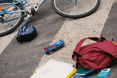 Child`s backpack and bike on pedestrian crossing after dangerous. Collision with a car stock photo