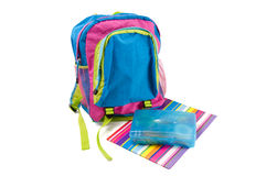 Child's backpack with folder and pencil box Royalty Free Stock Photos