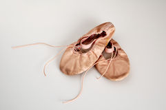Child's ballet shoes. A young girl's first pair of ballet slippers stock images