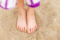 Child's bare feet in sand Royalty Free Stock Photography