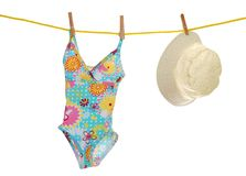 Child's bathing suit and beach hat on clothesline Stock Images