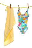 Child's bathing suit beach towel on clothes line Royalty Free Stock Photos