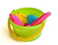 A child's beach bucket Stock Photos