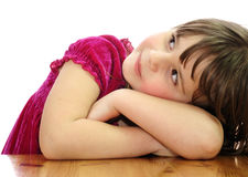 Child's beauty on a table Royalty Free Stock Photography