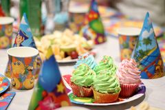 A child`s birthday party with a cake and other sweets stock photo