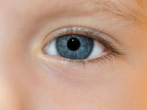 Child's blue eye. Child's blue eye - macro. Selective focus with shallow depth of field Royalty Free Stock Photos
