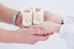 Child S Boots In Parents Hands. Stock Images