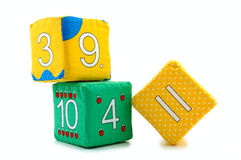 Child's bricks. Child's cloth mathematical bricks (blocks) on overwhite background stock photos