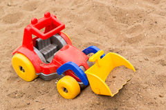 Child's Bright Plastic Digger Toy Stock Photo