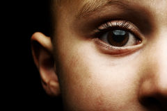 Child's Brown Eye. A close up shot of a 3 year old child with brown eyes Royalty Free Stock Photos