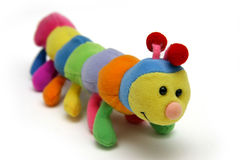 Child's caterpillar soft-toy. Multi colored soft sponge and fabric kid's caterpillar toy Royalty Free Stock Photo