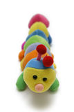 Child's caterpillar soft-toy. Multi colored soft sponge and fabric kid's caterpillar toy Royalty Free Stock Photography